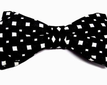 Black and white bowtie with sharp edges