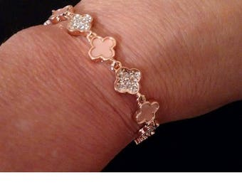 Gold plated flower CHARM bracelet baby pink and  rhinestone . very pretty