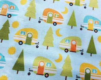 Caravan cotton on pale blue, fun fabric for anyone with a holiday home, available by metre, half and quarter lengths. 100% quality cotton