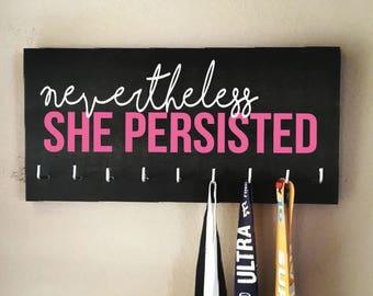 "Race Medal Holder - ""Nevertheless, SHE PERSISTED"" white and pink with black background - Elizabeth Warren"
