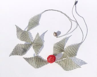 Necklace red berries. Nature in a contemporary jewel.