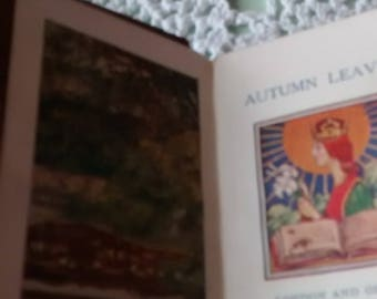 A tiny Autograph book 1926 and an even smaller book of poems called Autumn Leaves.
