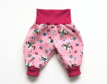 Pink baby harem pants. Bubble pants with horses and cowgirls. Comfy slouchy infant pants with pink fold over waistband and cuffs.