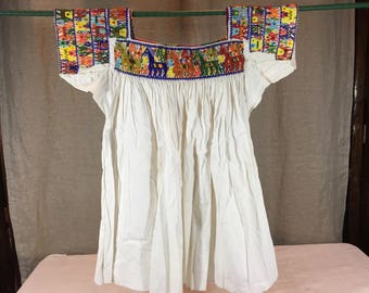 Vintage beaded huipil blouse from Puebla region of Mexico