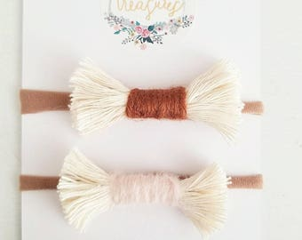 Woven tapestry fringe bow duo