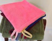 Exfoliating double sided net washcloth.