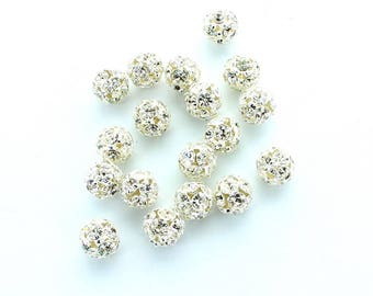 Rhinestone balls 10mm in silver plated settings.  Made by Preciosa.  Price is for 4 balls.