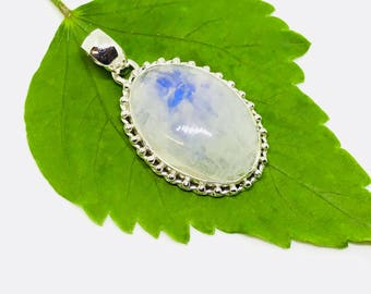 Rainbow Moonstone Pendant/ necklaces set in Sterling silver 925. Natural authentic moonstone. Length - 1.71 inch long. Open back.