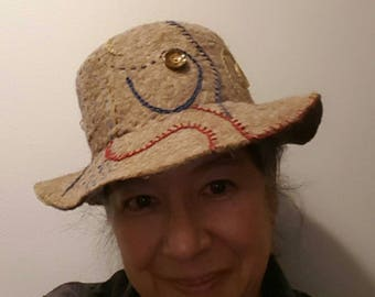 Wide brimmed button hat with stitching embellishment