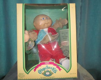 Cabbage Patch Kids Doll Antone Llyod Born in 1985. He has never been removed form box. Part of Betty's collection. Make him yours.