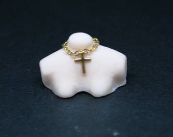 Bust With Gold Cross Necklace