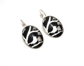 Stud Earrings, cage has birds on a black background