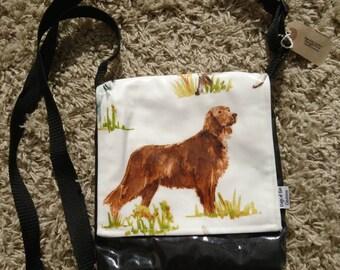 Dog retriever small messenger. Oilcloth