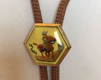 Vintage , Cowboy On Horse, Bolo Tie. Embossed and Glass.