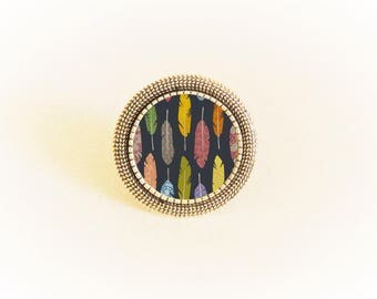 Ring silver pendant and adjustable multicolored feathers on Navy background