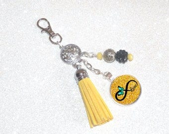 Jewelry bag Keychain yellow tassel, beads and cabochon infinity