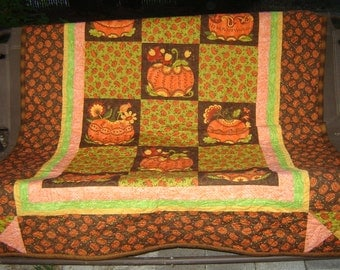 """Throw quilt for cool evenings fits outdoor bench swing, your chaise lounge, couch... 71.5"""" X 53"""". Fun pumpkin fabrics with pumpkin quilting."""