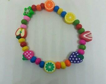 Elastic bracelet fruit and wood beads