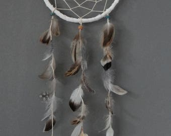small dream catcher with sea shell