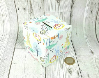 Nursery Money Box perfect for Baby's 1st Birthday with sweet Playground theme featuring Hedgehogs & Rabbits. Great for Babys 1st Christmas