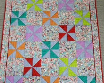 """Colorful Pinwheel Quilt with Beautiful Print Fabric - Suitable as a baby quilt, teen quilt, or adult lap quilt - Measures approx. 46"""" x 62"""""""