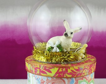 Small glass cloche. Diorama with rabbit and small Christmas wreath.