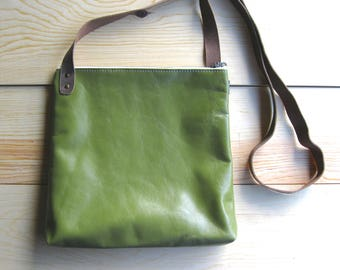 Crossbody Bag - Green Leather. Medium Messenger Style Bag with Brown Leather Crossbody Strap. Brass Metal Zipper and Lined with Gray Linen