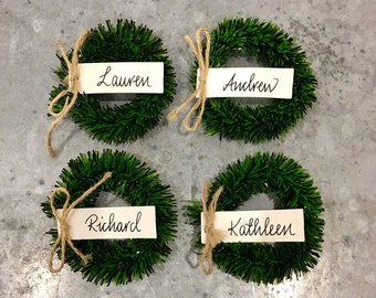 Mini Wreath Place Card Holders with White Place Cards. Cool, Calligraphy, Modern Design, Table Settings, Christmas Party.