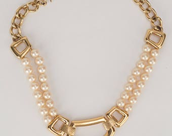 YSL 1980s vintage faux pearl bib necklace with gold tone statement pendant.