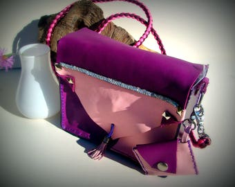 small purple and pink leather shoulder bag