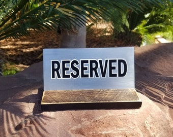 Reserved table sign.Rustic wooden reserved sign. Wood and metal reserved sign.