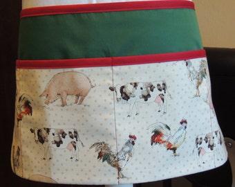 Handy farm print multi-purpose apron with green background