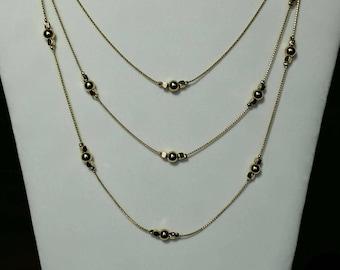 Beautiful shiny gold multi strand necklace