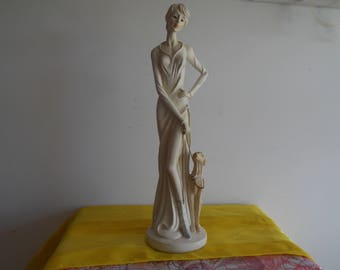 A very attractive figure of an elegant lady with her dog.