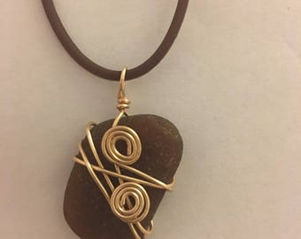 Brown sea glass necklace wrapped in gold wire