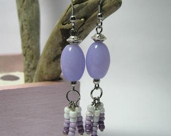 Pair of earrings in purple tones