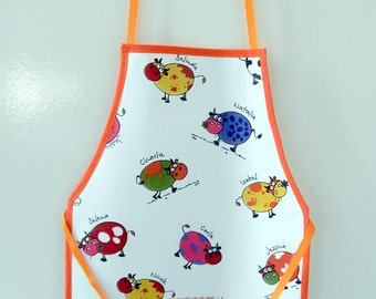 Apron customizable child in oilcloth printed cows