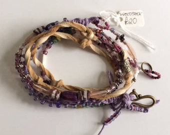 Multi wrap around Boho-chic bracelet, handmade with trade beads, leather lace and macrame work. For festivals and summer wear.