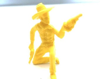 Miniature Yellow Plastic Cowboy