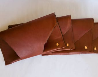 ELE Leather Clutch Bag With Copper Triangle - A stylish and minimalist clutch