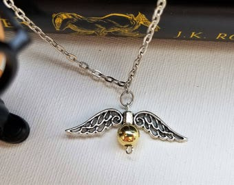 Harry Potter inspired Golden Snitch pendant necklace on silver chain