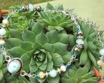 Larimar, Pyrite, Aquamarine and pearl bracelet.