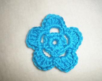 Set of four crochet flowers
