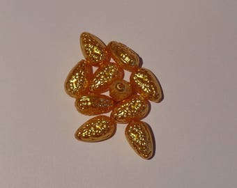 10 golden yellow embossed beads