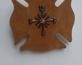 Maltese cross clock