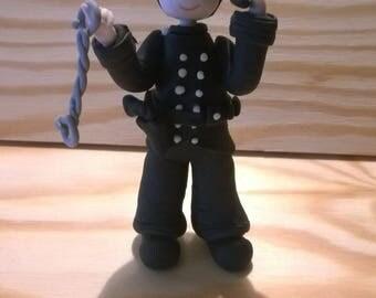 Decorative figurine: policeman made cold porcelain