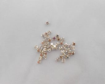 Set of 10 square 3 x 4 mm rhinestone spacer beads. (9071176)