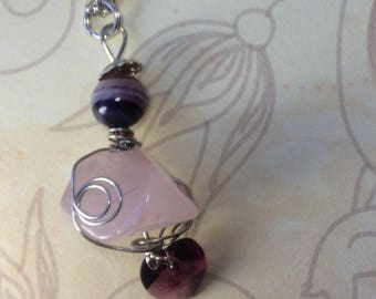 Rose quartz pendant with attached purple Swarovski heart, purple striped agate bead and a silver plated chain