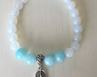 Bracelet, stretchy roll on, 7 1/4 inches, Hamsa Hand, charm, aqua glass beads, round beads, white beads, cloudy white, antiqued silver