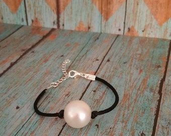 Faux Pearl/Knotted cord Bracelet.
